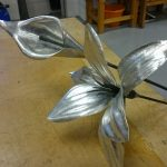 Beautiful copies of flowers created in the Art Metalwork course.