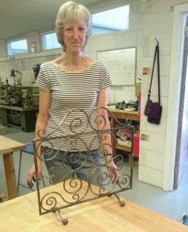 A lovely fire screen made in wrought mild steel
